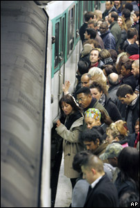 Passengers crowd the platform at the Gare de L'Est Metro station in Paris