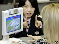 An immigration official fingerprints an arriving foreigner at Tokyo's Narita airport on 20 November 2007