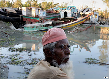 An elderly Bangladeshi cyclone affected man rests on the bank of a river near the devastated ferry terminal in Chalabangha village, on the southern coastal area of Bangladesh