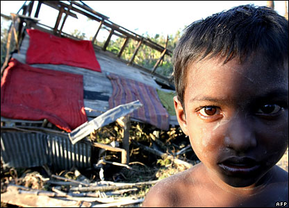 A Bangladeshi cyclone affected child stands in front of their devastated house in Chalabangha village, on the southern coastal area of Bangladesh