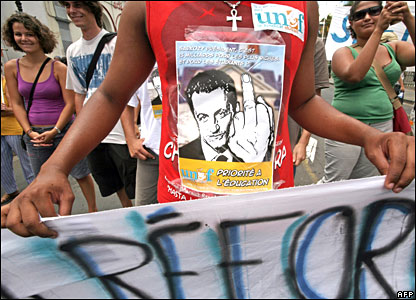 A man wearing an anti-Sarkozy T-shirt protests at Saint-Denis in the Indian Ocean French department island of Reunion on 20 November 2007
