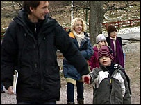 parents and children arriving at a school