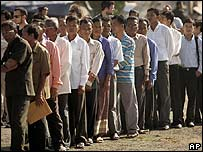 Cambodians line up to enter the hearing at the genocide tribunal