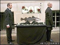"""Greenpeace mock """"cod funeral"""". Image: Getty"""