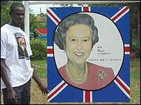Artist Aii Katongole with his painting of the Queen