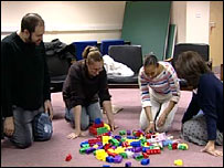 Parents using building blocks