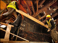 Workers helping to restore the Cutty Sark