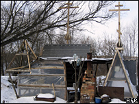 An outdoor summer-time kitchen covered with snow belonging to the doomsday group in the village of Nikolskoye,