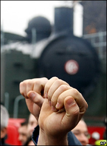 Striking railway workers raise their fists in a vote to continue striking at the maintenance depot in Lille, northern France