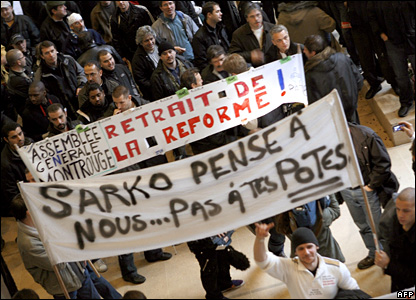 "Rail workers strike demonstrating in Paris carrying a banner saying: ""Think about us Sarko... not your friends!"""