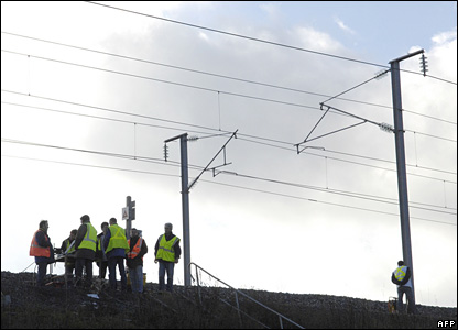 French rail workers repair damaged tracks and cables on the high-speed TGV line near Varredes, in eastern Paris