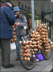 Jim Young captured this onion seller making a sale in Swansea.