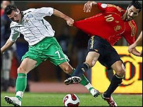 Northern Ireland's Ivan Sproule in action against Daniel Guiza of Spain