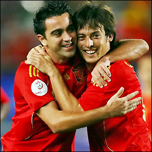 Xavi celebrates his goal with David Silva