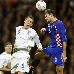 Crouch rises for a ball with Josip Simunic