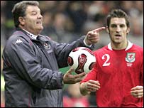 Wales manager John Toshack gives the ball to wing-back Sam Ricketts in Germany