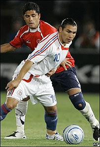 Salvador Caba�as (de rojo) y Miguel Riffo