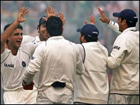 India celebrate after Sourav Ganguly (far left) removes Mohammad Yousuf
