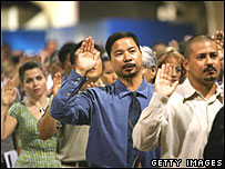 Immigrants are sworn in as US citizens during ceremonies in July 2007 in Pomona, California