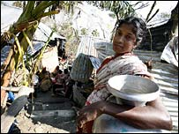 Woman collects water in cyclone-hit area, 21 November 2007