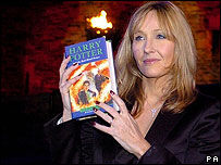 JK Rowling with a copy of Harry Potter and the Half-Blood Prince