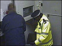 Colin Dixon and one of the robbers on CCTV (Picture from Kent Police)