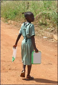 Young girl carrying XO laptop
