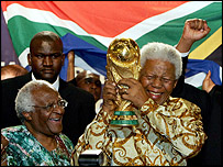 Nelson Mandela and Archbishop Desmond Tutu celebrate South Africa being awarded the 2010 World Cup