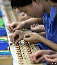 Assembling toys in a Chinese factory