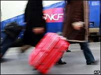Passengers board a SNCF train in Marseille, southern France