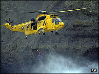 An RAF Rescue helicopter rescuing the crew