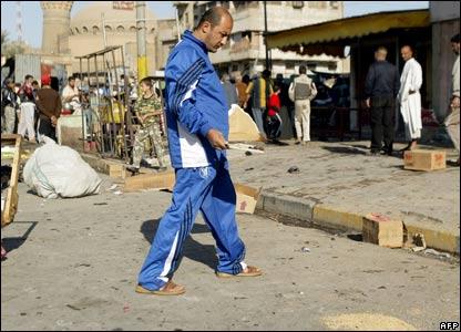 A man surveys the damage after the bomb at Ghazil market