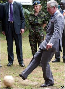 Prince Charles kicks a football