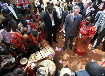 Prince Charles meets residents of a poor area of Uganda