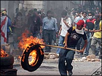 A demonstrator burns a tyre in Sucre