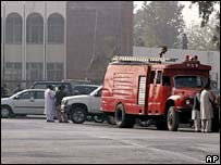 Pakistan's officials and a fire engine at the site of a suicide bombing in Rawalpindi
