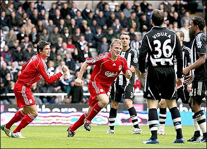 Dirk Kuyt celebrates after scoring Liverpool's second