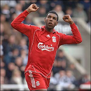 Ryan Babel celebrates scoring Liverpool's third