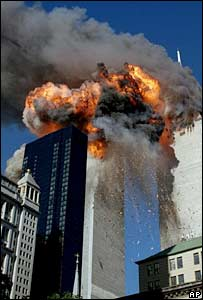 Smoke, flames and debris erupts from one of the World Trade Center towers o 11 September 2001