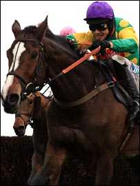Sam Thomas and Kauto Star jump the third-last at Haydock.