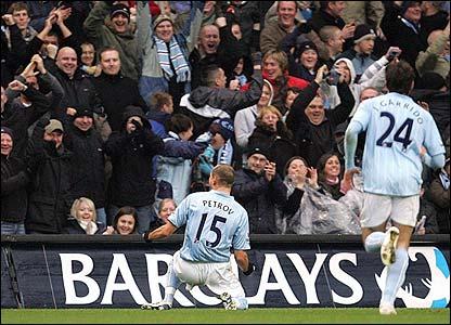 Martin Petrov celebrates giving Man City the lead