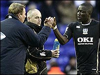 Sulley Muntari gets the thanks of Portsmouth manager Harry Redknapp after his goal against Birmingham