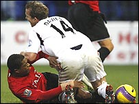 Kevin Davies and Patrice Evra