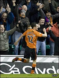 David Robertson celebrates scoring the opening goal for Dundee United