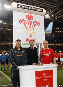 Prince William  stoods with the cup honouring his name along with South Africa's rugby team captain John Smit and Wales captain Gethin Jenkins before the kick-off Barry Batchelor/ WPA Rota/PA Wire