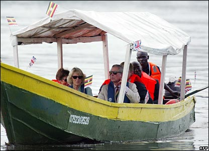 Prince Charles and wife Camilla (front L) take a ride on the river Nile in Jinja, Uganda,