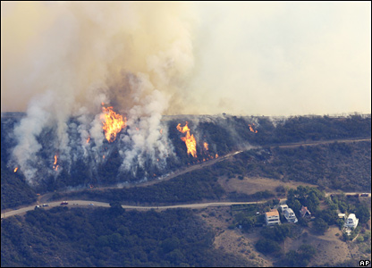 Fires in the Malibu hills approach houses