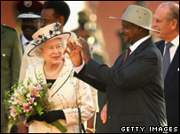 Queen Elizabeth II smiles as the President of Uganda Yoweri Museveni