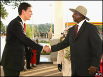 UK Foreign Secretary David Miliband and President Museveni shake hands