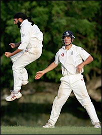 Monty Panesar (left) celebrates as Alastair Cook looks on